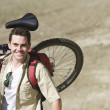 CaucasiMCarrying Mountain Bike — Stock Photo #21900401