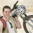 Stock Photo: MCarrying Mountain Bike