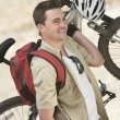 Caucasian Man Carrying Mountain Bike — Stock Photo