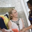 Stock Photo: Shop Assistant Helping Customer At Clothes Shop