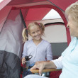 Grandmother And Granddaughter At Entrance To Tent — Stock Photo