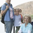 Girl With Mother And Grandmother By The Lake — Stock Photo