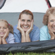 Mother, Daughter And Granddaughter Smiling From Tent — Stock Photo #21900595