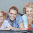 Mother, Daughter And Granddaughter Smiling From Tent — Stock Photo