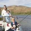 Father And Sons Fishing From A boat — Stock Photo