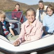 Caucasian Family Of Five In Speedboat - Foto Stock