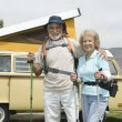 Senior Couple With Walking Poles And Campervan — Stock Photo #21900617