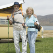 Senior Couple With Walking Poles And Campervan - 图库照片