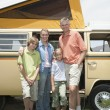 Family Of Four Standing By Campervan - Foto de Stock