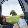 Siblings Relaxing In Tent — Stock Photo
