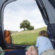Stock Photo: Siblings Relaxing In Tent