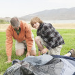 Father And Son Setting Up Tent — Stock Photo #21900667