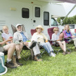 family sitting outside rv home — Stock Photo