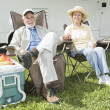 Relaxed Couple Sitting In Folding Chairs — Stock Photo