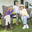 Mother, Daughter And Granddaughter Outside RV Home - Stock Photo