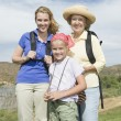 Mother, Daughter And Granddaughter Hiking - Stock Photo