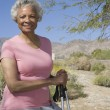 Stock Photo: Mature WomWith Walking Poles