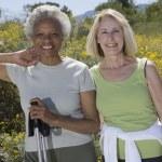 Senior Women Stand With Walking Poles — Stock Photo #21900755