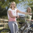 Mother And Daughter With Mountain Bikes - Stock Photo