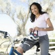 Woman Adjusts Cycling Helmet On Mountain Bike — Stock Photo
