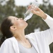 Woman Drinking Mineral Water — Stock Photo #21900941