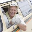 Royalty-Free Stock Photo: Senior Man In Driver\'s Seat Of Campervan Looking Through Window