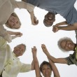 Multiethnic Holding Hands In A Huddle — Stock Photo