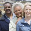 multiethnic friends standing in a row — Stock Photo