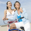 Mother And Daughter With Bicycle — Stock Photo