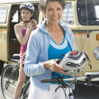 Mother And Daughter Ready To Go For Cycle Ride - Stock Photo