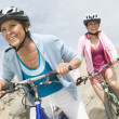 Mother And Daughter Riding Bicycles - Stock Photo