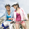 Mother And Daughter With Mountain Bikes - Photo