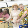 Stock Photo: Couple With Bicycle And Friend In RV