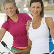 Women With Bicycles - Stock Photo