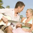 Couple With Guitar - Stockfoto