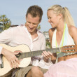 Happy Young Couple With Guitar - Stock Photo
