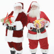 Men In Santa Claus Outfits Holding Gift Boxes — Stock Photo