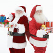 Men In Santa Claus Outfits Standing With Gifts — Stock Photo