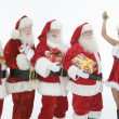 Men Dressed In Santa Claus Outfits With Mrs. Claus Holding Mistletoe — Stock Photo