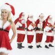 Group Of Men Dressed As Santa Claus Standing With Mrs. Claus In Foreground — Stock Photo
