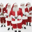 Royalty-Free Stock Photo: Group Of Men Dressed In Santa Claus Outfits