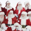 Happy Men In Santa Claus Outfits — Stock Photo