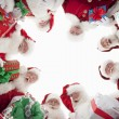 Men In SantClaus Outfits Forming Huddle — Stock Photo #21901581