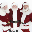Happy Men In Santa Claus Outfits Standing Together — Stock Photo #21901583