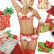 Stock Photo: Mrs. Claus In Underwear Surrounded By Gifts