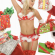 Mrs. Claus In Underwear Surrounded By Gifts — 图库照片