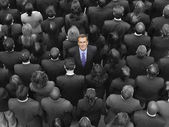 High angle view of a businessman standing amidst businesspeople — Fotografia Stock