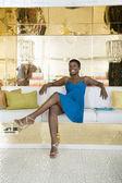 Happy Woman Sitting In A Lavish Store — Stock Photo
