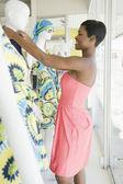 Female Shop Assistant Dresses Mannequin — Stock Photo