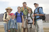 Happy Family With Backpacks — Stockfoto